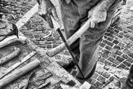 builds: Old craftsman builds Hacksaw using the steel of old scythes. Stock Photo