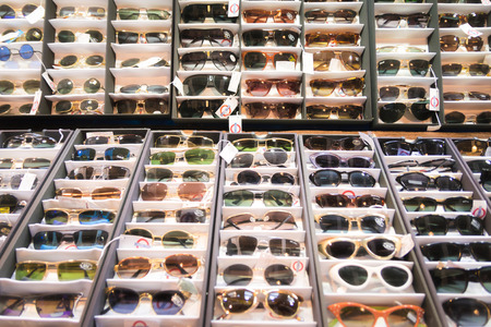 70s: Stall exhibits many colorful vintage sunglasses 70s.