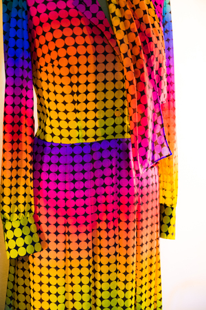 Detail of a vintage dress with a pattern of colored dots. Stock Photo