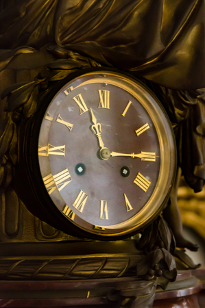 antique table: detail of antique table clock with manual winding