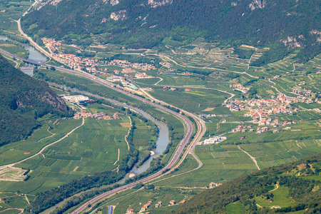 spread around: The landscape of the Valley of the Adige, that is spread around the eponymous river, is characterized by a wide valley, surrounded by high mountains.