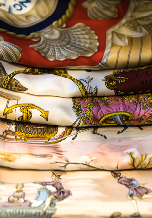 Background consists of five colored silk scarves. Фото со стока