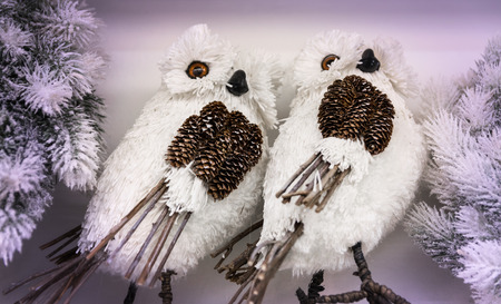 natural materials: Couple of white owls made from natural materials such as pine cones and twigs.