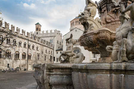 Detail of the Neptune fountain in Cathedral Square, Trento, Italy