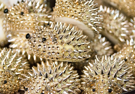 reflectance: Background formed by golden hedgehogs to use as a paperweight.