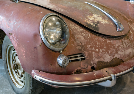 restored: VERONA, ITALY - CIRCA MAY 2015: Detail of old German rusty car called beetle to be restored.