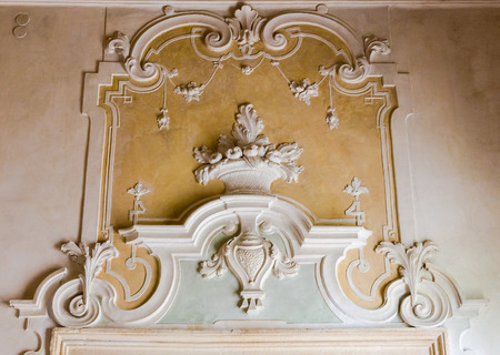 victorian fireplace: The ornament of a fireplace hood in a Venetian neo classical villa. Stock Photo