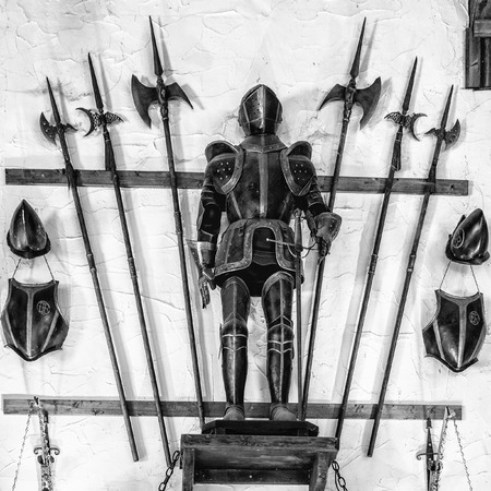 longsword: Medieval armor exposed along with metal halberds. Stock Photo