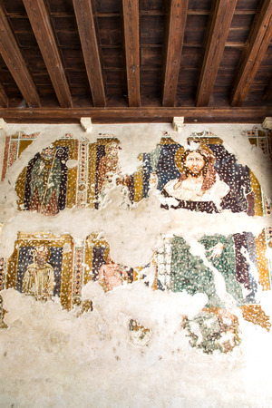 restored: Fresco damaged to be restored in a cloister of a medieval church.