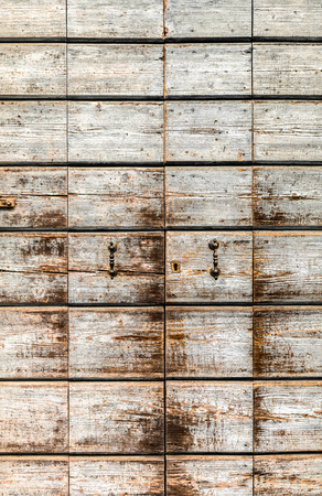 discolored: Texture formed by a discolored old wooden portal. Stock Photo