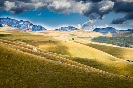 meadow: View of meadows in the mountains that create sinuous lines. Stock Photo