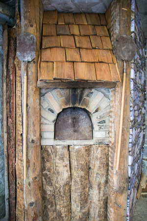 woodburning: Detail of an outdoor wood-burning oven for baking bread. Stock Photo