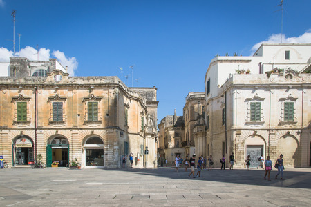 Lecce, Italy - August 6, 2014: Detail of the buildings in baroque style in Cathedral Square, Lecce. Redakční