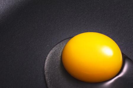 nonstick: Egg yolk just put in a nonstick skillet.