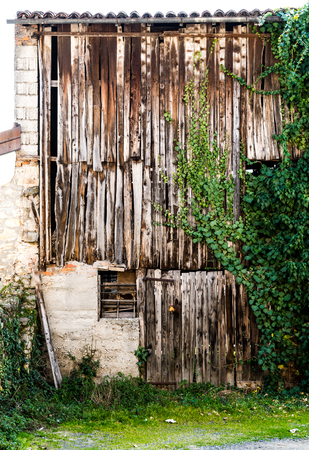 enclosed: Old barn enclosed by old wooden planks. Stock Photo