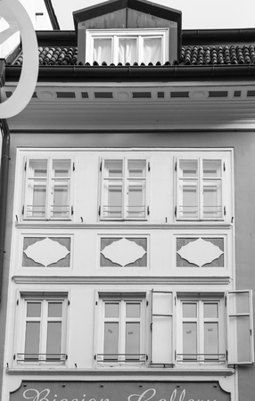 garret: Detail of the white facade of a historic residence in Bolzano, Italy.