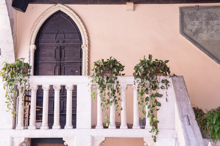 balcony door: Balcony and front door side of the medieval courthouse in Soave, Italy. Editorial