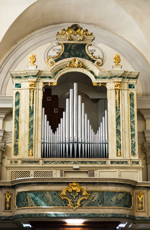 abbot: Marostica, Italy - April 12, 2016: Organ and choir loft above the entrance of the church of Saint Anthony Abbot.