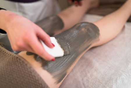 clays: Anti cellulite draining mud that promotes the drainage of liquids and elimination of toxins. Stock Photo