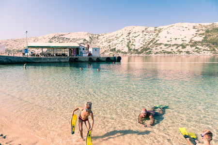 clear waters: Rab, Croatia - August 9, 2015: Snorkeling in the clear waters of the island of Rab, Croatia.