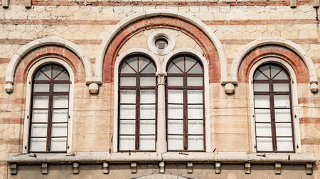 arched: Old medieval arched windows in Romanesque style. Stock Photo