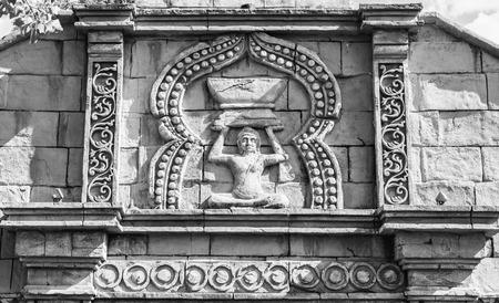 sculpted: External sculpted facade of a Hindu temple.
