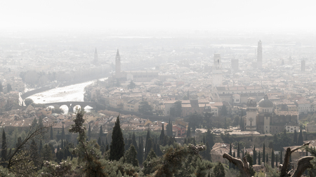 romeo: Panorama of Verona (Italy) in the fog. The city of Romeo and Juliet in a foggy winter day.