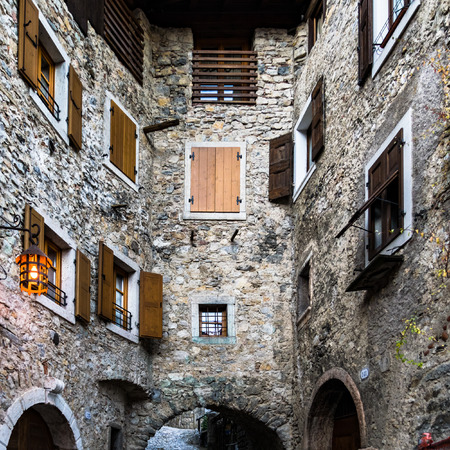 many windows: Many windows overlook in a narrow alley in a Medieval Italian village.