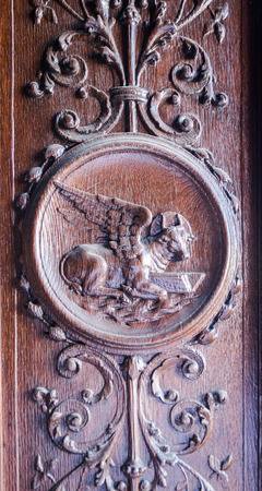 evangelist: Winged ox with book between the front legs representing St Luke the Evangelist.