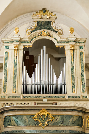 choral: Marostica, Italy - April 12, 2016: Organ and choir loft above the entrance of the church of Saint Anthony Abbot.