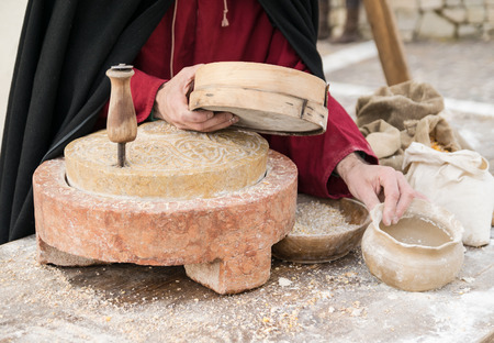 millstone: Ancient millstone that was turned by hand to produce flour and homemade bread.