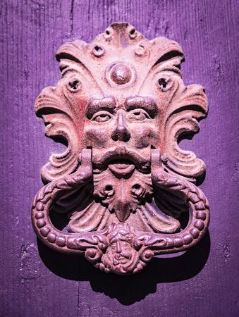 door knocker: Antique door knocker of an old door.