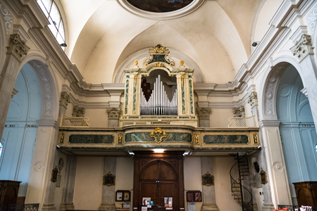 the abbot: Marostica, Italy - April 12, 2016: Organ and choir loft above the entrance of the church of Saint Anthony Abbot.