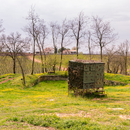 migratory birds: Camouflaged hut used to hunt migratory birds in Italy. Stock Photo
