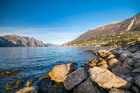 lake sunset: Panorama of Lake Garda (Italy) near the town of Malcesine called the pearl of the lake. Stock Photo