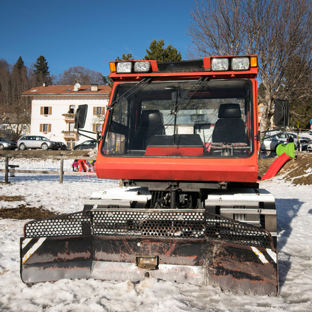 snow grooming machine: Snowcat parked at the end of a ski slope.