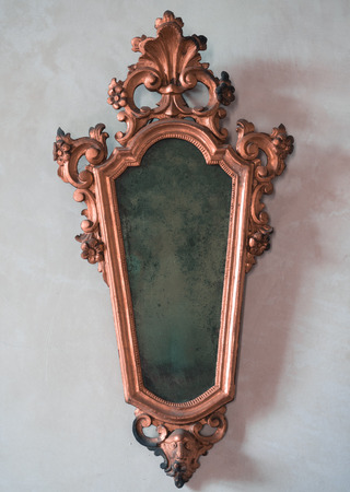 mirror frame: Classic antique mirror with copper colored frame engraved.
