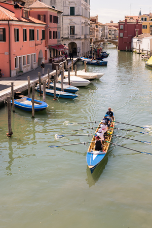 boat crew: Venice, Italy - May 20, 2016: Female crew is training on a rowing boat in Venice.