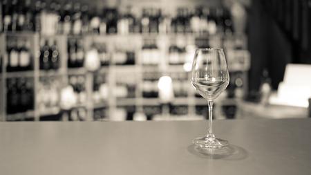 White wine glass in an Italian wine shop.