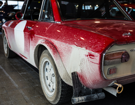 dirty car: Old red vintage car after a race on dirt.