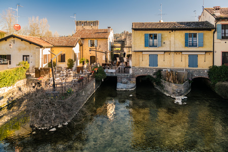 fraction: Borghetto is a fraction of the municipality of Valeggio sul Mincio, in the province of Verona. The buildings were built on the river that flows beneath the houses.