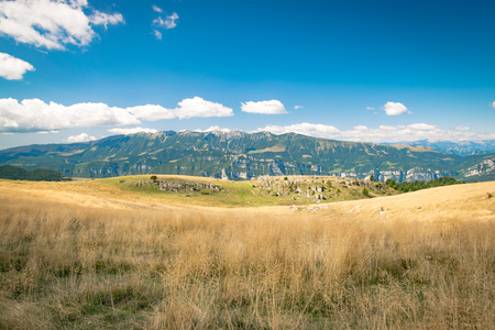 View of meadows in the mountains that create sinuous lines. Stock Photo