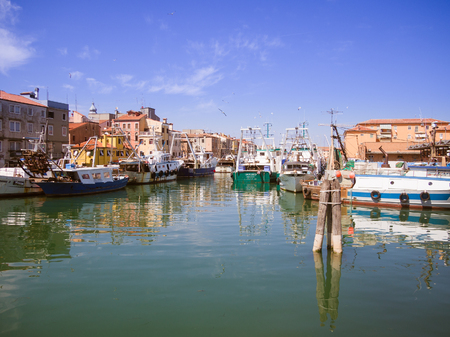 trawler net: Chioggia, Italy - April 30, 2017: Fishing boats moored in a canal in Chioggia, Venetian Lagoon, Italy. Editorial