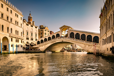 View of the Rialto Bridge in the early light of sunset.