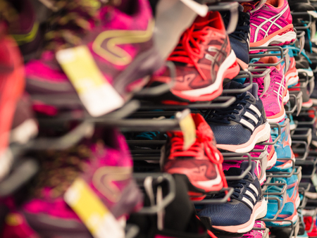 Verona, Italy - March 19, 2017: Background made of running shoes exhibited at a sporting goods store. Editorial
