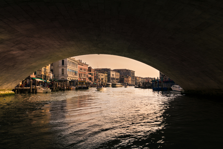Venice, Italy - April 23, 2017: Grand canal at sunset seen from under the Rialto Bridge, Venice, Italy. Editorial