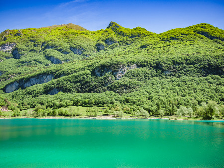 surrounded: Panorama of Lake Tenno surrounded by Italian mountains.