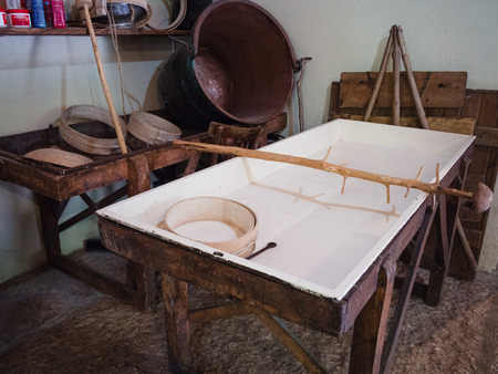 Equipment for transforming milk into cheese in an ancient Italian dairy.