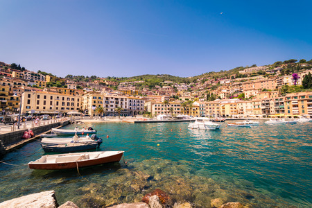 Porto Santo Stefano, Italy - June 24, 2017: Harbor seafront and village skyline, italian travel destination. Monte Argentario, Tuscany, Italy. Editorial