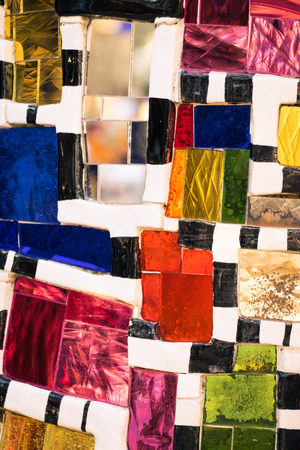Texture made from mosaic of colored glass pieces.
